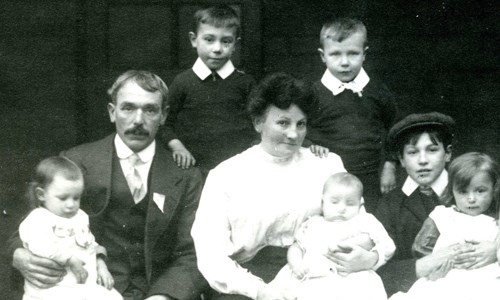 Old family photo of parents and six children