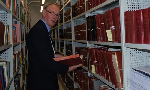 Researcher in archive repository