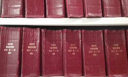 Red magistrates books in archive catalogue