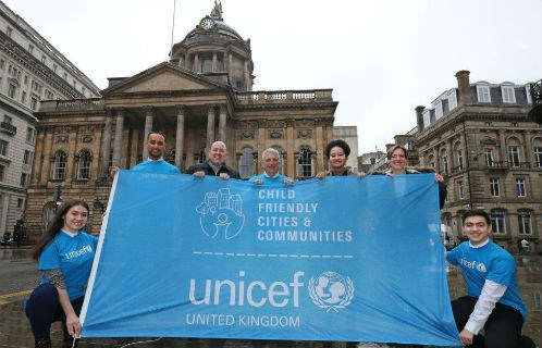 UNICEF UK team holding UNICEF banner